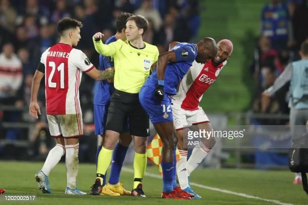 Lisandro Martinez of Ajax, referee Ruddy Buquet, Allan Nyom of Getafe CF, Ryan Babel of Ajax during the UEFA Europa League round of 32 first leg...