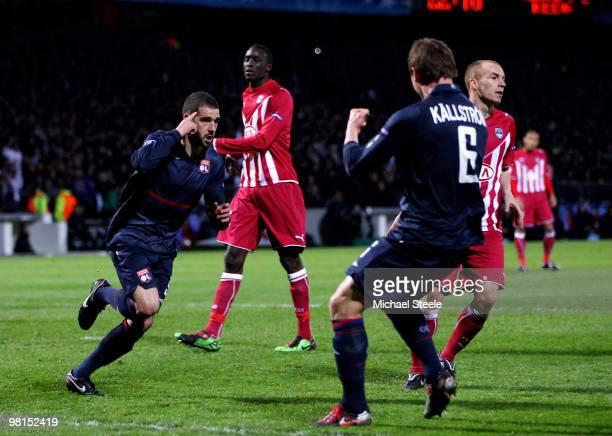 Lisandro of Lyon celebrates scoring the third goal during the Lyon v Bordeaux UEFA Champions League quarterfinal 1st leg match at the Stade de...