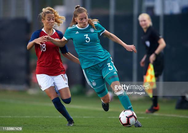 Lisann Kaut of Germany competes for the ball with Celin Bizet Ildhushoy of Norway during the 14 Nations Tournament match between U19 Women's Germany...