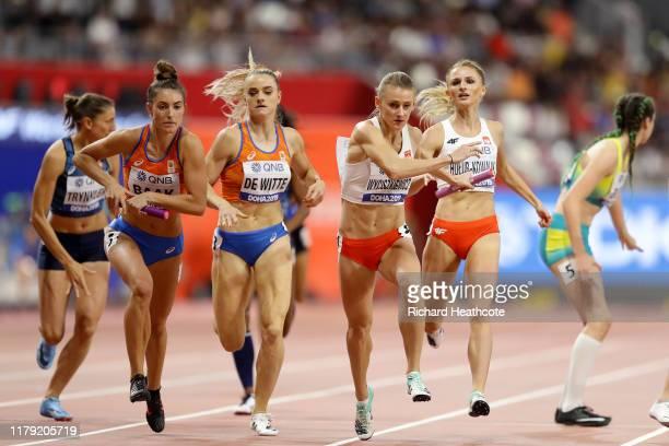 Lisanne De Witte and Bianca Baak of Netherlands and Małgorzata Hołubkowalik and Patrycja Wyciszkiewicz of Poland compete in the Women's 4x400 metres...