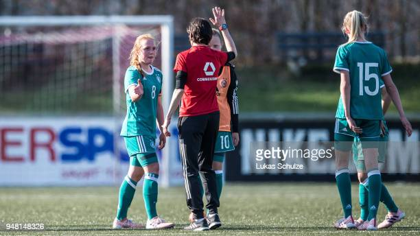 Lisanne Graewe of Germany and Head Coach Bettina Wiegmann of Germany shake hands after winning the U15 Girls friendly match between Netherlands and...
