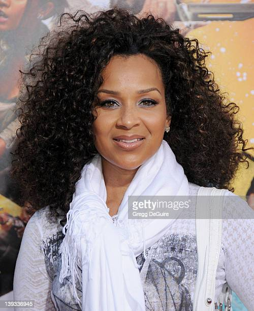 LisaRaye McCoy and daughter arrive at the Los Angeles Premiere of The Losers at the Grauman's Chinese Theater on April 20 2010 in Hollywood California