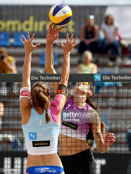 Lisa-Sophie Kotzan of Germany in action against Anna-Lena Grüne and Kira Walkenhorst during the match against Anna-Lena Grüne and Kira Walkenhorst of...