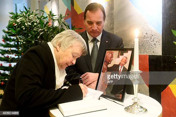 Lisbet Palme widow of murdered Social Democrat party leader Olof Palme signs the condolence book together with Stefan Lofven present Social Democrat...