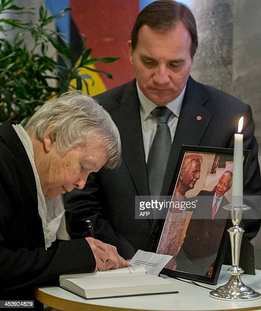 Lisbet Palme widow of murdered Social Democrat party leader Olof Palme signs Nelson Mandela's condolence book together with Stefan Lofven present...