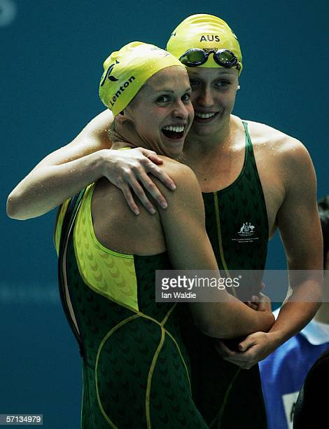 Lisbeth Lenton and Alice Mills of the Australian relay team wave to the crowd as they celebrate winning the gold medal in the women's 4x100m...