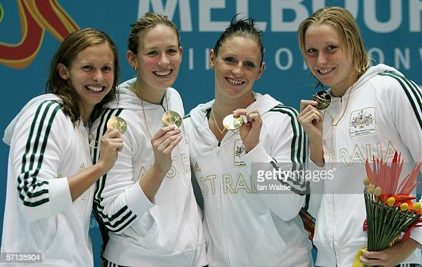 Lisbeth Lenton Jodie Henry Shayne Reese and Alice Mills of the Australian relay team pose with their gold medals as they celebrate winning the...