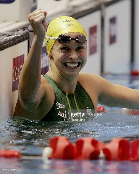 Lisbeth Lenton of Australia celebrates after she won the final of the womens 100 metres freestyle at the Melbourne Sports Aquatic Centre during day...
