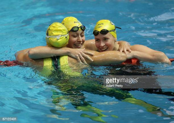 Lisbeth Lenton of Australia celebrates with her teammates after she won the final of the women's 100 metres freestyle at the Melbourne Sports Aquatic...