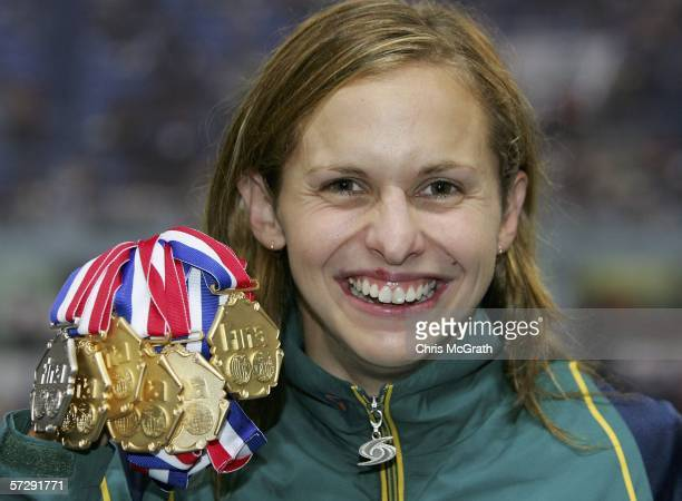 Lisbeth Lenton of Australia poses with her five gold medals and one silver medal during day five of the FINA World Swimming Championships at Qi Zhong...