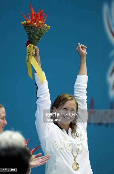 Lisbeth Lenton of Australia poses with her gold medal after the womens 100 metres freestyle final at the Melbourne Sports Aquatic Centre during day...