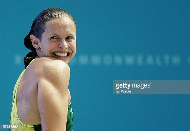Lisbeth Lenton of Australia smiles to the crowd as she celebrates winning the women's 50m freestyle final at the Melbourne Sports Aquatic Centre...