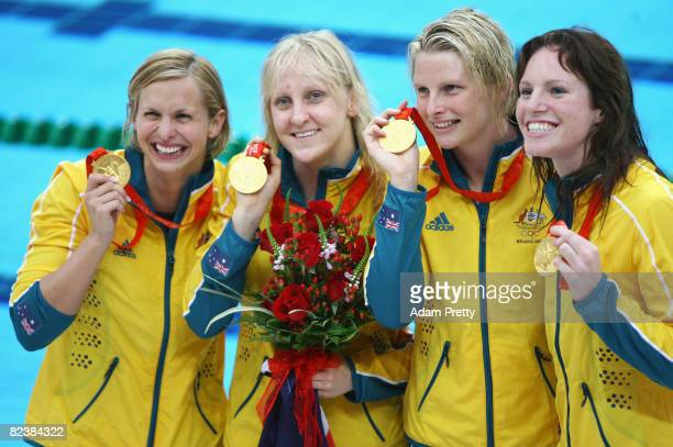 Lisbeth Trickett, Jessicah Schipper, Leisel Jones and Emily Seebohm of Australia pose with their gold medals from the Women's 4x100m Medley Relay...