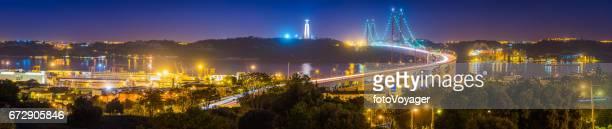 lisbon 25 de abril bridge waterfront panorama illuminated night portugal - statua di cristo re foto e immagini stock