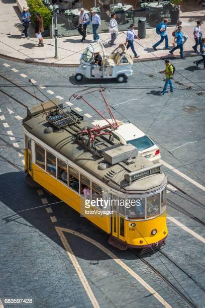 lisbon aerial photograph of iconic yellow tram and tourists portugal - praça do comércio imagens e fotografias de stock