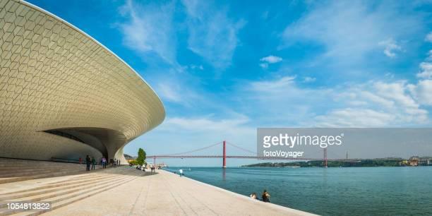 Lisbon MAAT museum gallery overlooking 25 Abril bridge waterfront Portugal