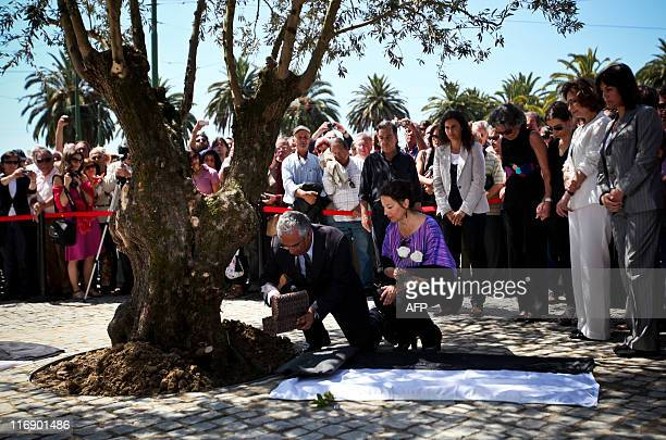 Lisbon Mayor Antonio Costa and Portuguese Culture Minister Gabriela Canavilhas place the ashes of Portuguese novelist Jose Saramago at the foot of an...