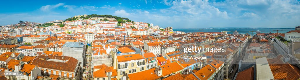 Lisbon panoramic view across terracotta rooftops of Baixa waterfront Portugal : Stock Photo
