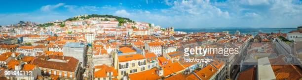 Lisbon panoramic view across terracotta rooftops of Baixa waterfront Portugal