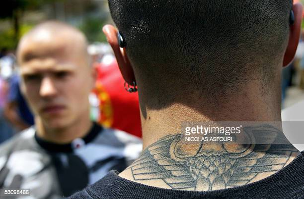 A right wing protester with a nazi tatoo is seen as he gathers with others for a march trough central Lisbon 18 June 2005 About 400 people marched...