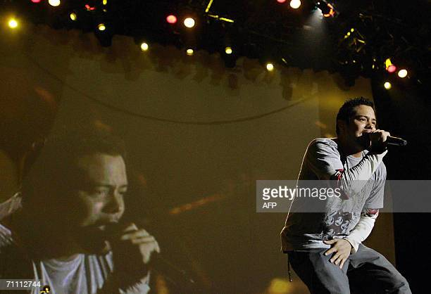American Andy Vargas a member of Mexican Carlos Santanas band sings during the third day of Rock In Rio festival at Bela Vista park in Lisbon 02 June...