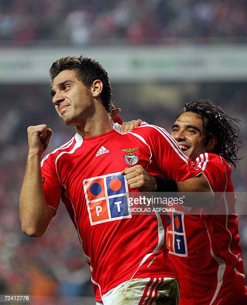 Benfica's Katsouranis celebrates with team mate Miccoli after he scored the opening goal against SL Benfica during their Premier League football...