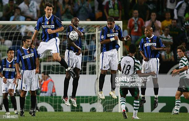 InterMilan's Patrick Vieira blocks the ball as he stands in the wall while Sporting's Nani shoots a free kick at the Alvalade stadium in Lisbon 12...