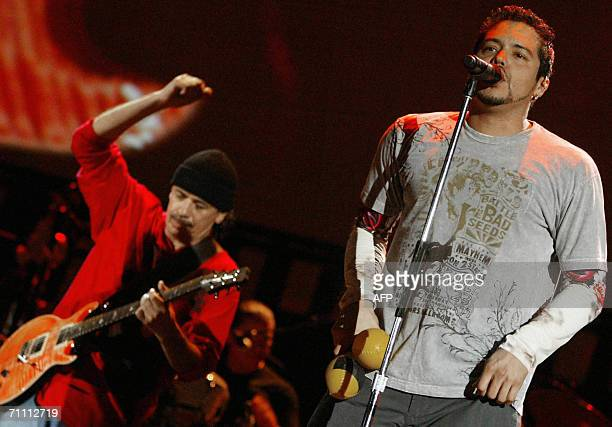 Mexican musician Carlos Santana playS the guitar as band member Andy Vargas singS on the third day of Rock In Rio festival at Bela Vista park in...