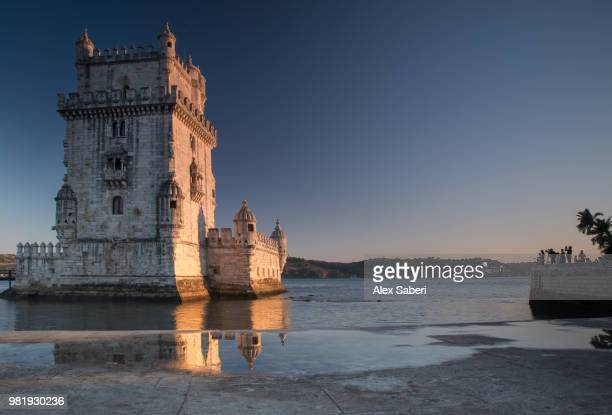 The Belem Tower or the Tower of Saint Vincent reflected at sunset.