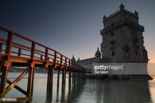 The bridge to the Belem Tower or the Tower of Saint Vincent at sunset.