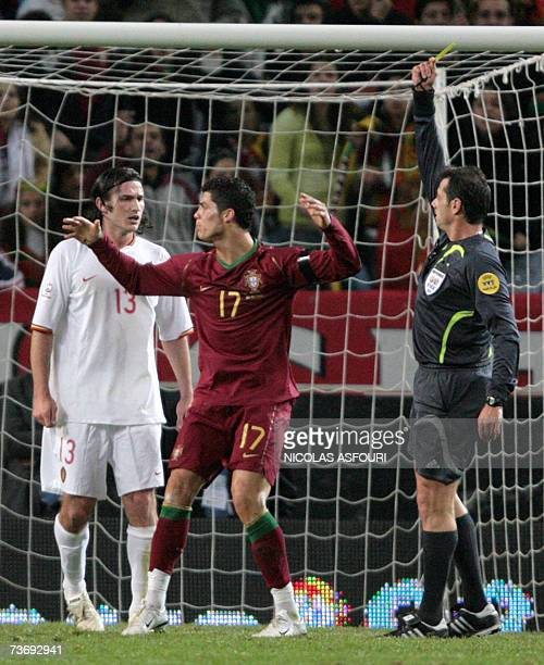 Portugal's Cristiano Ronaldo receives a yellow card from referee Kyros Vassaras during the Euro 2008 groupe A qualifiying football match against...