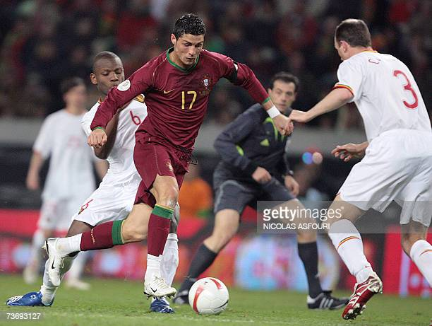 Portugal's striker Cristiano Ronaldo vies with Belgium's Philippe Clement during their Euro 2008 groupe A qualifiying football match at Alvalade...