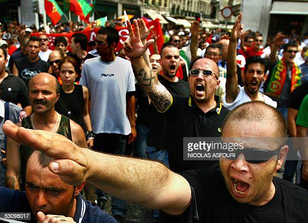 Rightwing protesters make the Nazi salute as they march trough central Lisbon 18 June 2005 About 400 people marched trough Lisbon to protest against...
