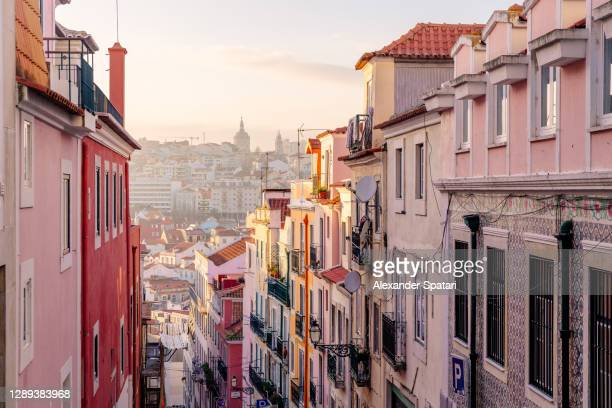 lisbon skyline at sunset, portugal - pink colour stock pictures, royalty-free photos & images