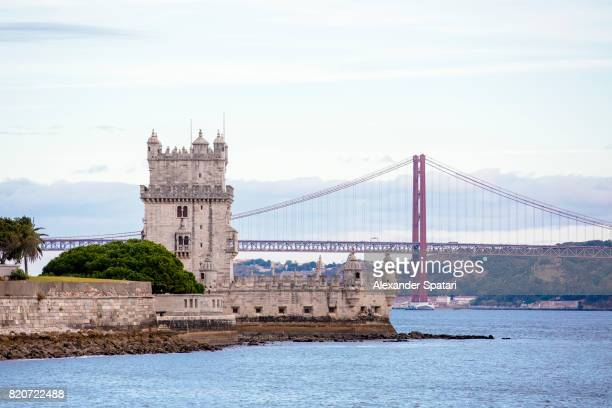 Lisbon skyline with Belem Tower and April 25th Bridge