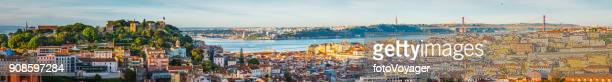 lisbon sunrise super panorama across castelo baixa and bridge portugal - panoramic stock pictures, royalty-free photos & images