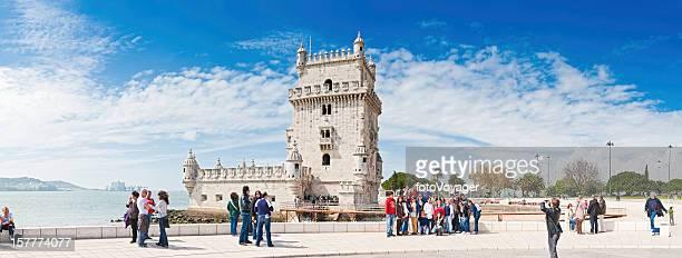 Lisbon tourists at the Belém Tower River Targus Portugal panorama
