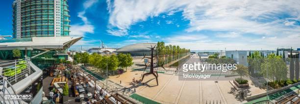 Lisbon tourists enjoying waterfront restaurants Parque das Nacoes panorama Portugal