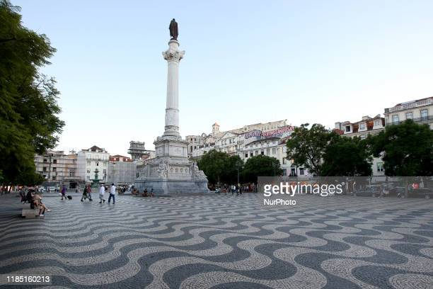 Lisbons central Dom Pedro IV square commonly known as the Rossio square is paved in black and white limestone waves a reference to Portugals maritime...