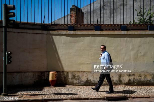 Lisbon's mayor Fernando Medina walks around the Alfama neighborhood in Lisbon on July 17, 2018. - Lisbon's city hall is giving keys of several...