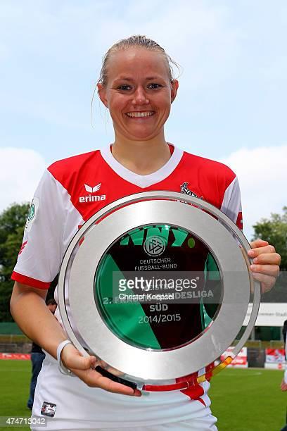 Lise Overgaard Munk of Koeln lifts the trophy after winning the Women's 2nd Bundesliga season after the Women's 2nd Bundesliga match between 1 FC...