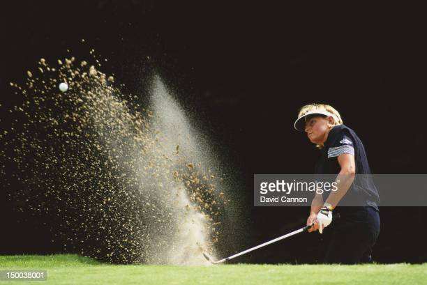 Liselotte Neumann of Sweden hits out of a bunker during the Weetabix Ladies British Open held on 15th August 1999 at Woburn Golf and Country Club...