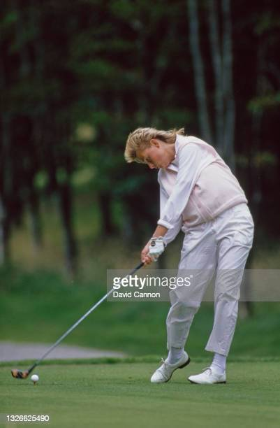 Liselotte Neumann of Sweden keeps her eyes on the golf ball whilst teeing off during the Weetabix Women's British Open golf tournament on 2nd August...