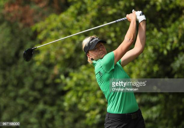 Liselotte Neumann of Sweden plays a tee shot on the eighth hole during the first round of the US Senior Women's Open at Chicago Golf Club on July 12...