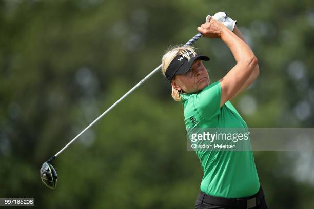 Liselotte Neumann of Sweden plays a tee shot on the ninth hole during the first round of the US Senior Women's Open at Chicago Golf Club on July 12...