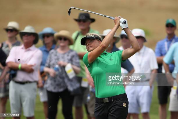Liselotte Neumann of Sweden plays her second shot on the 15th hole during the first round of the US Senior Women's Open at Chicago Golf Club on July...