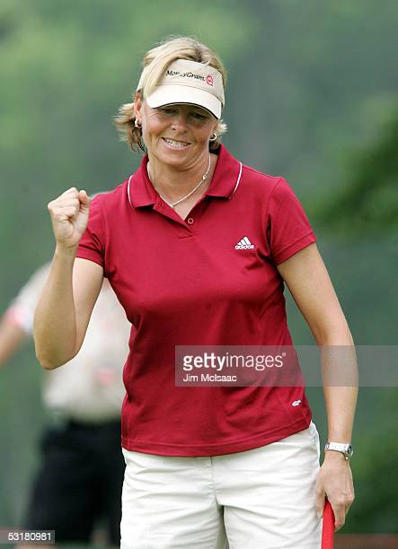 Liselotte Neumann of Sweden pumps her fist after defeating Cristie Kerr on the 15th hole during the second round of the HSBC World Match Play at...
