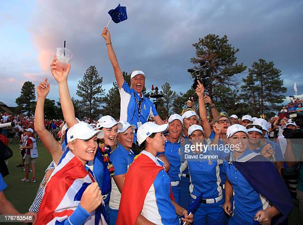 Liselotte Neumann of Sweden the European Team captain is held aloft by team embers after they had clinched the first ever victory on American soil...