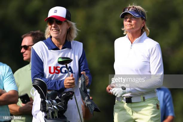 Liselotte Neumann, right, of Sweden with her caddie Evelyn Orley on the 18th hole during the second round of the U.S. Senior Women's Open...