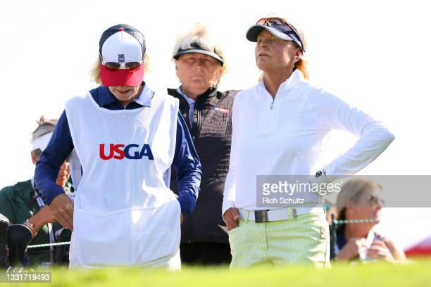 Liselotte Neumann, right, of Sweden with her caddie Evelyn Orley on the 12th hole during the second round of the U.S. Senior Womens Open Championship...
